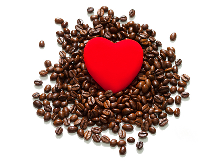 beans coffee isolated on a white background. red heart in coffee beans, concept of love and a holiday of valentine day.