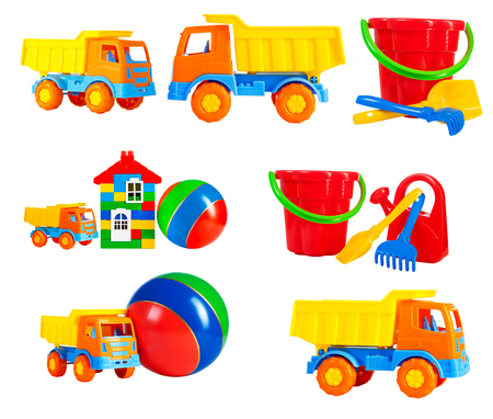 bright multi-colored toys for children isolated on a white background, a set. toys - machine truck, a ball, a toy house, a bucket, a rake, a shovel, a watering can isolated on a white background