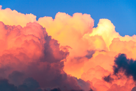 beautiful summer landscape with blue sky and cumulus clouds at sunset. abstract background