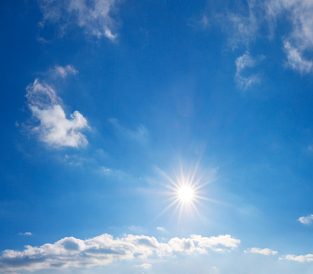 background from blue sky with white clouds and sun. summer landscape panorama. panoramic view