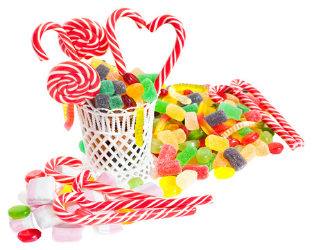 Panorama close up a background from colorful sweets of sugar candies and marmalade. Assortment candies panoramic view isolated on white background. Concept of holiday of Christmas and birthday