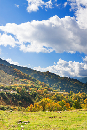 beautiful mountain landscape with blue sky and white clouds. rocky autumn scenery scenic view
