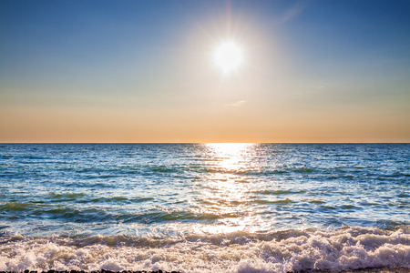 beautiful sea landscape with a sunset. evening blue sky over ocean. sea surf with waves 版權商用圖片