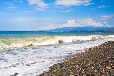 beautiful sea landscape with blue sky and white clouds. panoramic view of coast and sea. scenery with ocean waves surf on shore 版權商用圖片 - 117765146