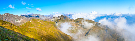 panorama of mountain top landscape. mountain scenery with blue sky and white clouds. panoramic view over  clouds