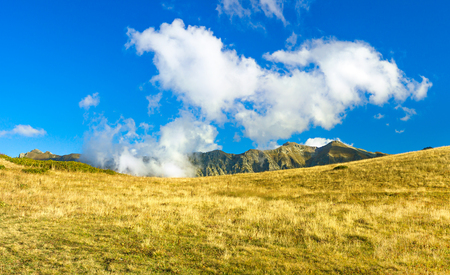 beautiful mountain landscape with blue sky and white clouds. rocky autumn scenery scenic panoramic view