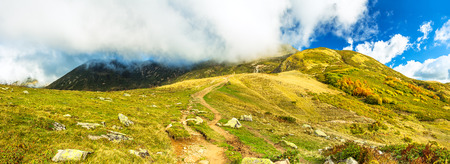 beautiful panorama mountain landscape with blue sky and white clouds. rocky autumn scenery scenic panoramic view 版權商用圖片 - 117765212