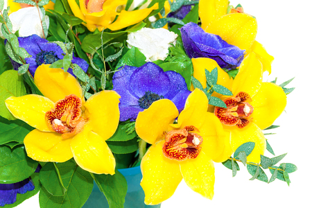 beautiful holiday bouquet of yellow orchids and blue anemones isolated on white background. holiday card with floral background