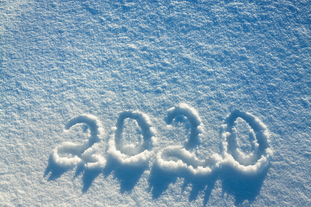 abstract  winter New Years and Christmas background from snow.text on snow 2020