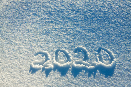 abstract  winter New Year's and Christmas background from snow.text on snow 2020