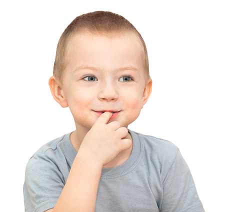 little child boy isolated on white background. child put his finger in his mouth