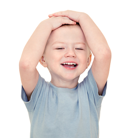 happy little  child smiles isolated on a white background. beautiful small  boy cheerful laughs. kid holds hands on head Stock Photo