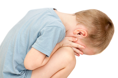 hurt a small child is crying isolated on white background. little boy tears wipes and close face with his hands