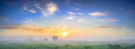 beautiful summer landscape panorama with sunrise and fog. panoramic view of sky and sunset Stock Photo