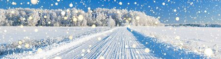 beautiful winter landscape panorama with road and forest. panoramic view of snow covered forest and field