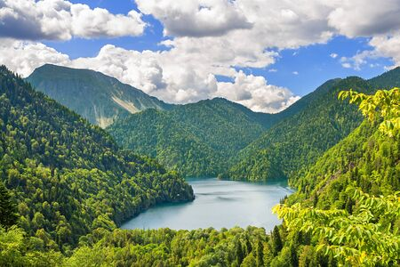 beautiful summer mountain landscape with highland lake. top view of forest high mountain lake