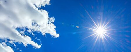 panorama with sun shines in a blue sky with cloud. hot summer weather panoramic view sky