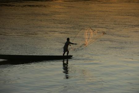 A fisherman on the Mekong photo