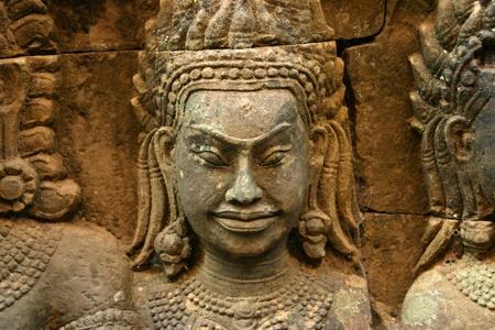 cambodge: A Hindu deity bas-relief in Angkor Stock Photo