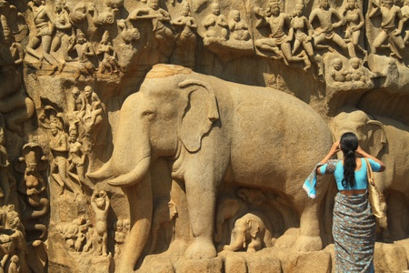 mamallapuram: Woman photographing ancient carvings