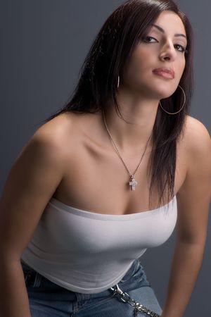 hottie: Twenty something fashion model crouching while looking down