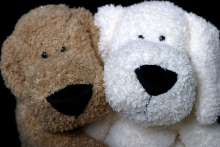 Two stuff dog hugging
