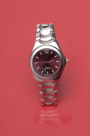 chrome man: Men sport watch on red reflective surface