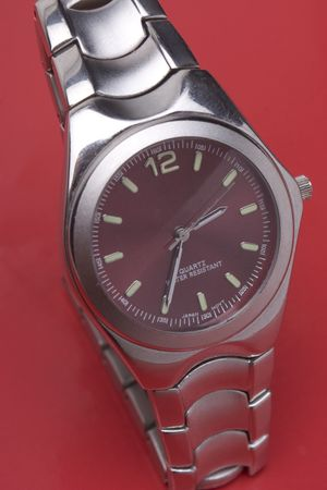 chrome man: Men sport watch on red background Stock Photo