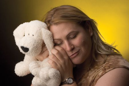 Wormn hugging a stuff dog Banco de Imagens