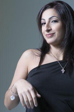 Fashion model in little black dress with corner smile photo