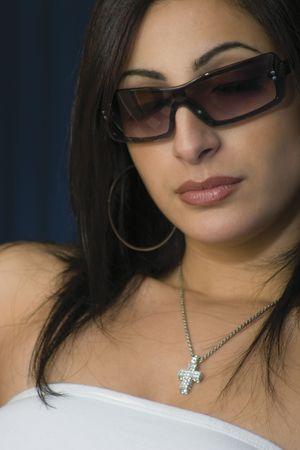 hottie: Twenty something fashion model in white tube top and hip sunglasses with her eye closes Stock Photo