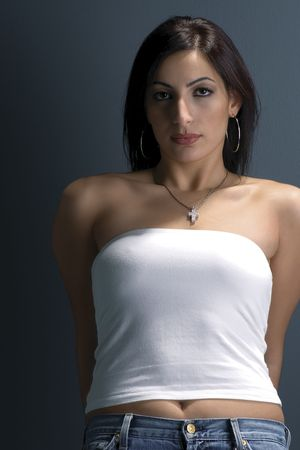 Twenty something fashion model in white tube top and jeans