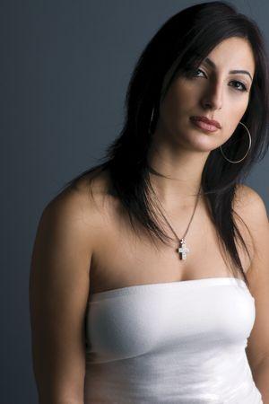 depress: Twenty something fashion model in white tube top looking depress
