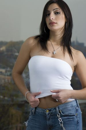 tube top: Twenty something fashion model in white tube top and jean with urban background