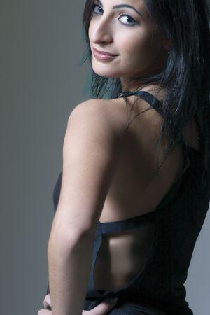 Fashion model looking over shoulder photo