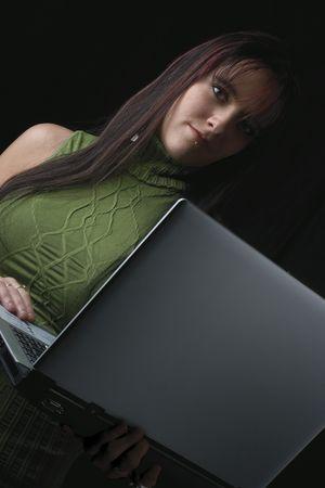 Twenty something fashion model working with laptop standing up