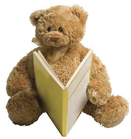 Kleine teddybeer lezing een gele boek Stockfoto