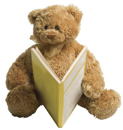 Small teddy bear reading a yellow book