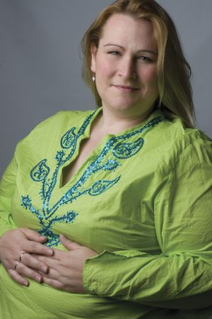 Female model in her thirties, over weight, with green top