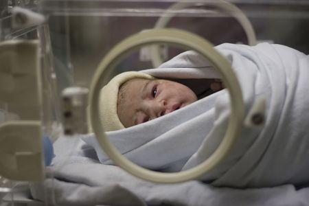 New born baby in incubator Stock Photo