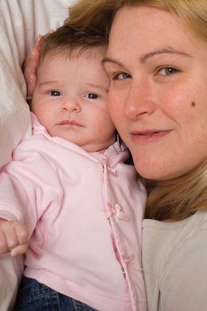 Portrait of a mother and her baby daugther being close together photo