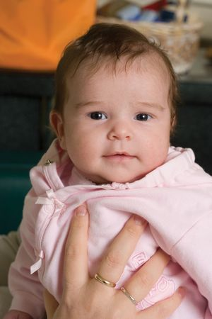 one month baby with a small smile, looking at the camera Stock Photo - 2021480