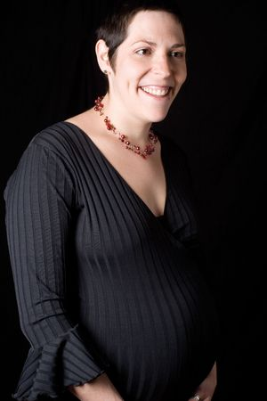 perky: portrait of a late twenty pregnant women looking perky with a great big smile Stock Photo