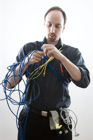 Computer technician trying to figure wires Imagens