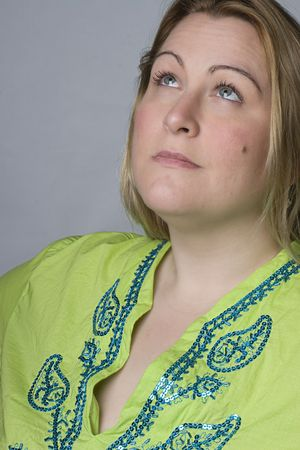 thirty something: Portrait of a thirty something overweight women in casual clothes looking up