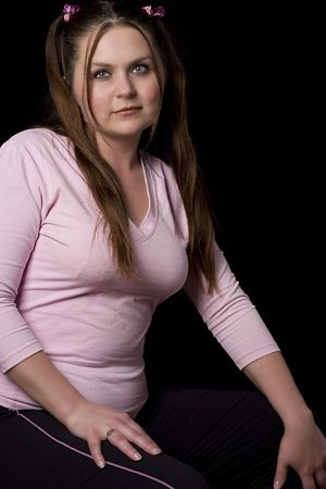 overweight students: Chubby girl in pink shirt Stock Photo