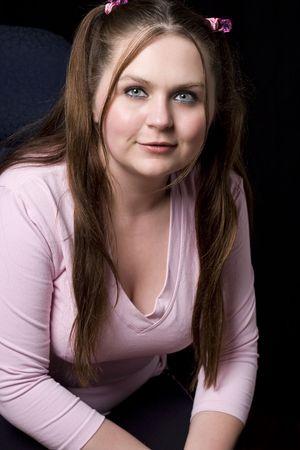 Chubby ragazza in camicia rosa sorridente Archivio Fotografico - 4946058