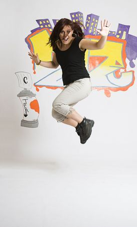 Late twenties break dancing girl in the middle of a jump Stock Photo
