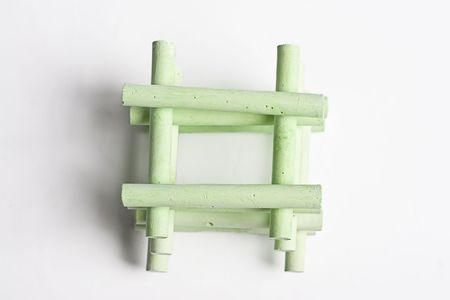 green chalk stack in a manner to create a house photo