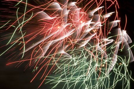 trailing: Red,green and white erratic firework display trailing in the wind